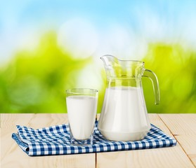 Glass of milk and jug