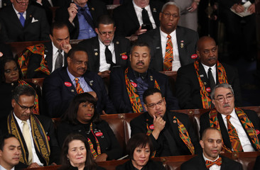 Democratic members of Congress listen to U.S. President Trump's State of the Union address in Washington