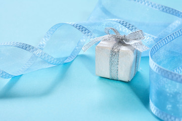 Gift box with ribbon on a blue background