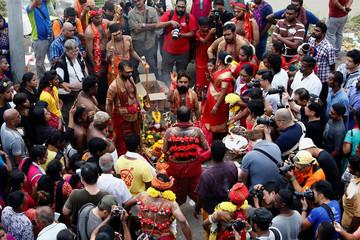 Hindu devotees take part in a procession during Thaipusam at Batu Caves in Kuala Lumpur