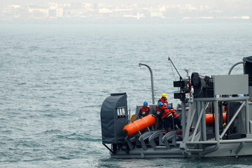 Taiwanese navy sailor release a training mine during a military drill in Kaohsiung's Zuoying naval base