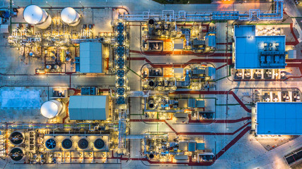 Aerial view petrochemical plant at night, Oil refinery build plant construction at night view from above, Business chemical oil and gas .