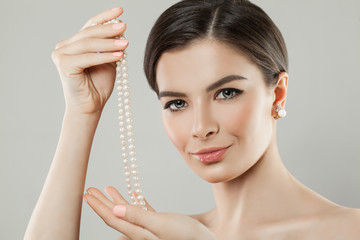 Beautiful Woman Holding White Pearls Jewelry