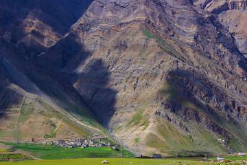 Long shot of settlements towards rocky mountain at Spiti Valley. Himachal Pradesh