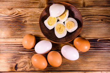 Boiled eggs on the old wooden table