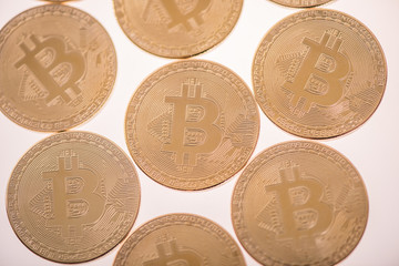gold bitcoin coins on white background