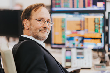 Man working in trading room, stock trader in the office