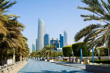 Foto op Aluminium Abu Dhabi Abu Dhabi Corniche walking area with landmark view of modern bui