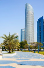 Abu Dhabi Corniche walking area with landmark view of modern bui