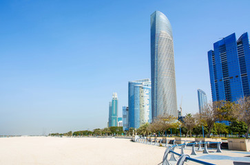 Abu Dhabi Corniche beach and walking area with landmark view of