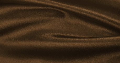 Smooth elegant brown silk or satin texture as abstract background. Luxurious background design...