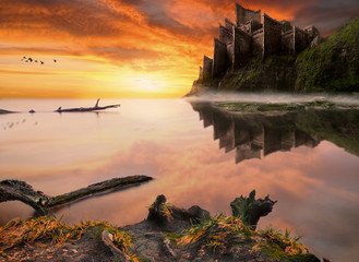 Wall Murals Orange Glow Fantasy fairytale castle on the sea cliff.