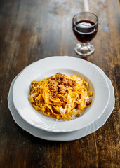 Tagliatelle with ragù. Tipycal homemade fresh pasta with meat  sauce.