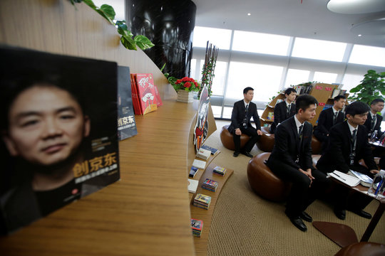 Members of JD.com's VIP delivery team attend a training session on business etiquette at the company headquarters in Beijing