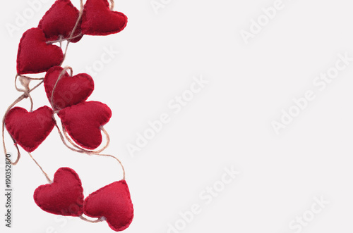 Red Felt Hearts On White Background With Copy Space Concept For