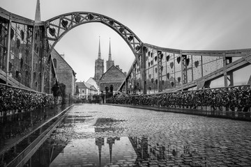 Tumski bridge in Wroclaw with reflection of cathedral