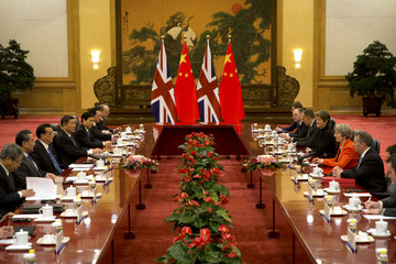Chinese Premier Li Keqiang, third from left, speaks as British Prime Minister Theresa May, second from right, listens during a meeting at the Great Hall of the People in Beijing