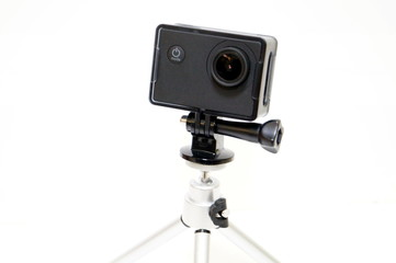 Action camera with tripod