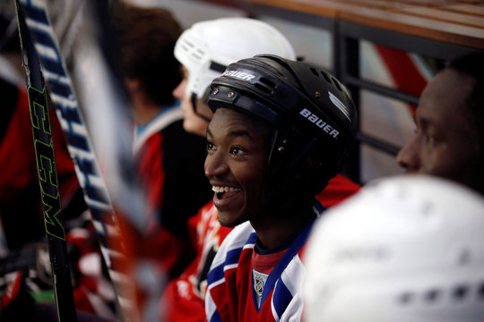 Member of Kenya's ice hockey team sits on the bench during a practice session in East Africa's only ice rink, in Nairobi