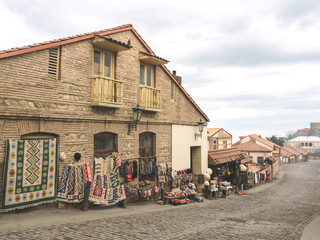 outdoor market with carpets and traditional souvenirs in Mestia, Georgia