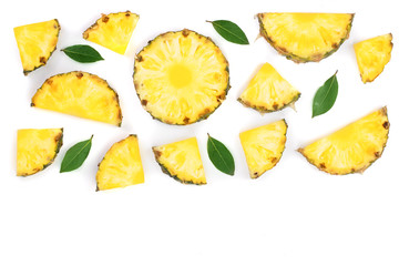 Sliced pineapple with green leaves isolated on white background with copy space for your text. Top view Wall mural