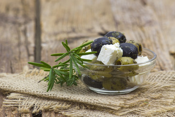 feta cheese and olives with herbs in olive oil