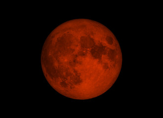 Blood moon or super moon concept or red moon on the dark sky on January 31, 2018. Elements of this image furnished by NASA.