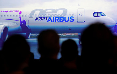 Journalists and guests watch an Airbus A321LR video during a presentation of the company's new long range aircraft in Hamburg-Finkenwerder