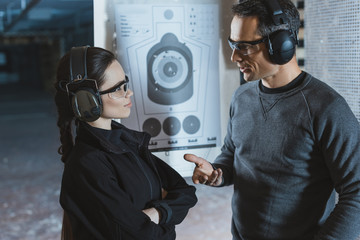 shooting instructor and client talking in shooting range