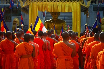 Meak Bochea Day in Cambodia, buddhist monks praying in front of a temple in Phnom Penh.