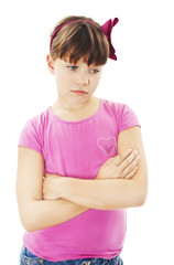 Sulky angry young girl child, sulking and pouting. Isolated on white background