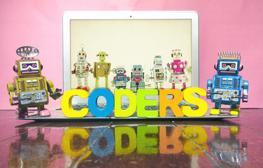 the word CODERS  with wooden letters
