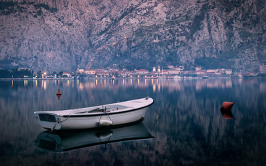 Calm scenic view with small fishing boat at Kotor Bay, Montenegro