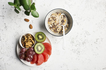 Fruit nuts bowl for a healthy break, breakfast, snack to the granola. Top view. flat lay.