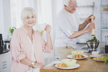 Smiling senior woman drinking tea