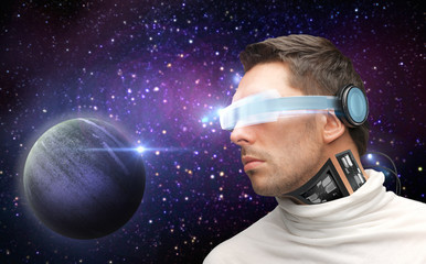 male robot in 3d glasses and sensors over space