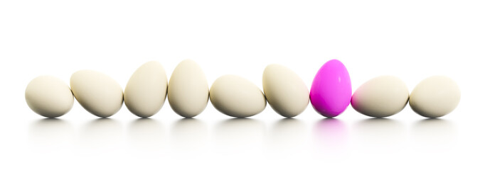a row of easter eggs one dyed in pink