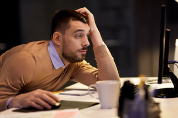 tired man on table at night office