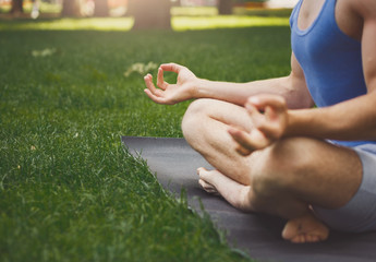 Young man practicing yoga, relax meditation pose
