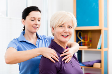 Physio giving shoulder massage to patient