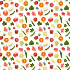 Fototapete - Background food texture. Seamless pattern of various fresh vegetables and fruits (grapefruit, currant leaf, green peas, tomato, apple, pomegranate) isolated on white background, top view, flat lay.
