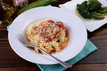 Fusilli pasta dish in the sauce with carrots and zucchini