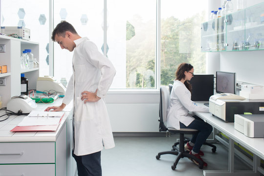 Man and woman working in laboratory