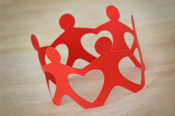 Paper people in a circle holding hands - Teamwork and love concept