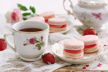 Homemade Pink Macaroons or Macarons with a cup of coffee
