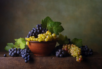 Still life with grapes in the bowl