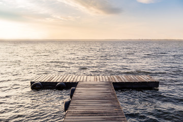 Peaceful empty wooden bridge in the morning sun