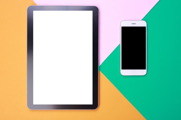 Top view mockup smartphone and tablet on pastel background