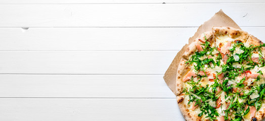 Italian pizza on white wooden background