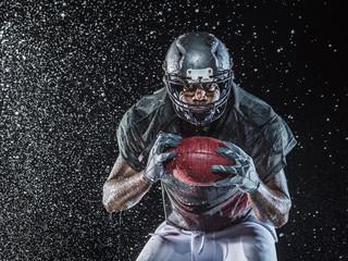 Water splashing on football player